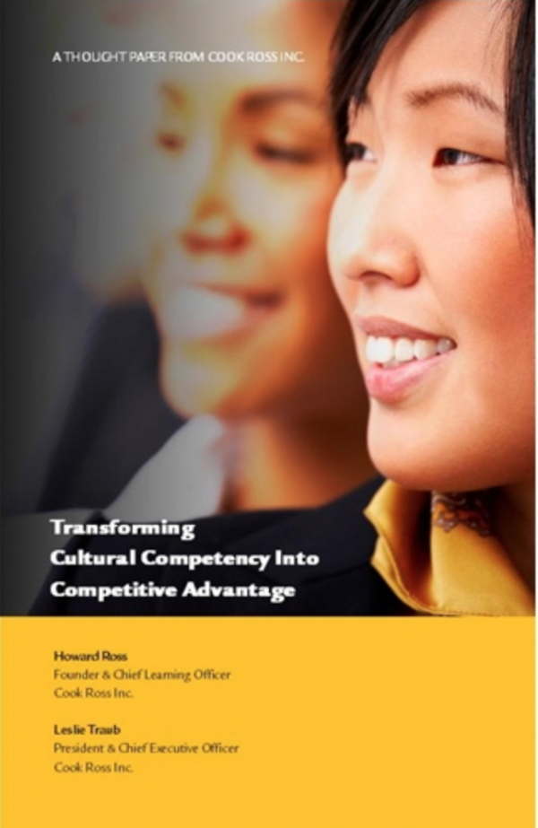 """Cover image of thought paper, """"Transforming Cultural Competency Into Competitive Advantage"""" featuring photo of two women"""